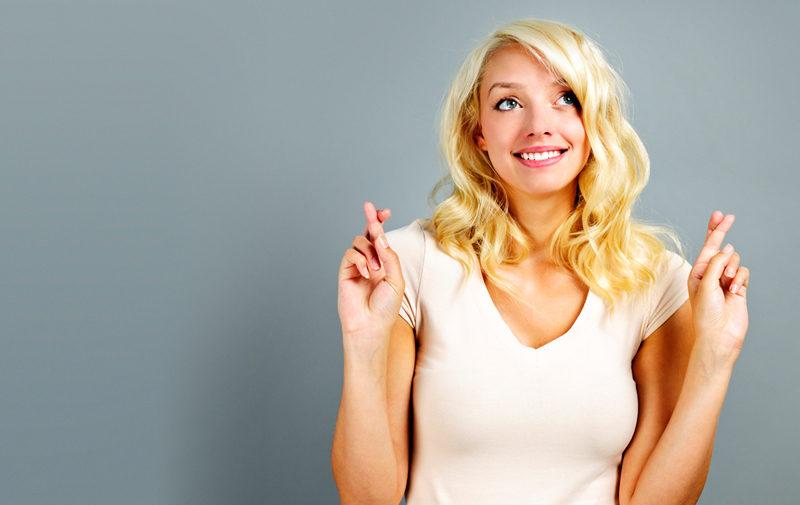 happy-woman-crossing-fingers