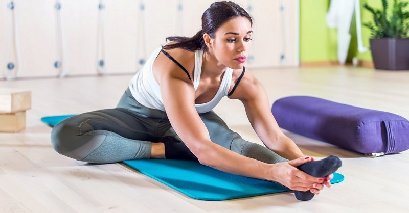 fit-woman-doing-stretching-pilates-exercises-in-fitness-studio-5