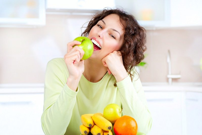 dieting-concept-healthy-food-young-woman-eats-fresh-fruit