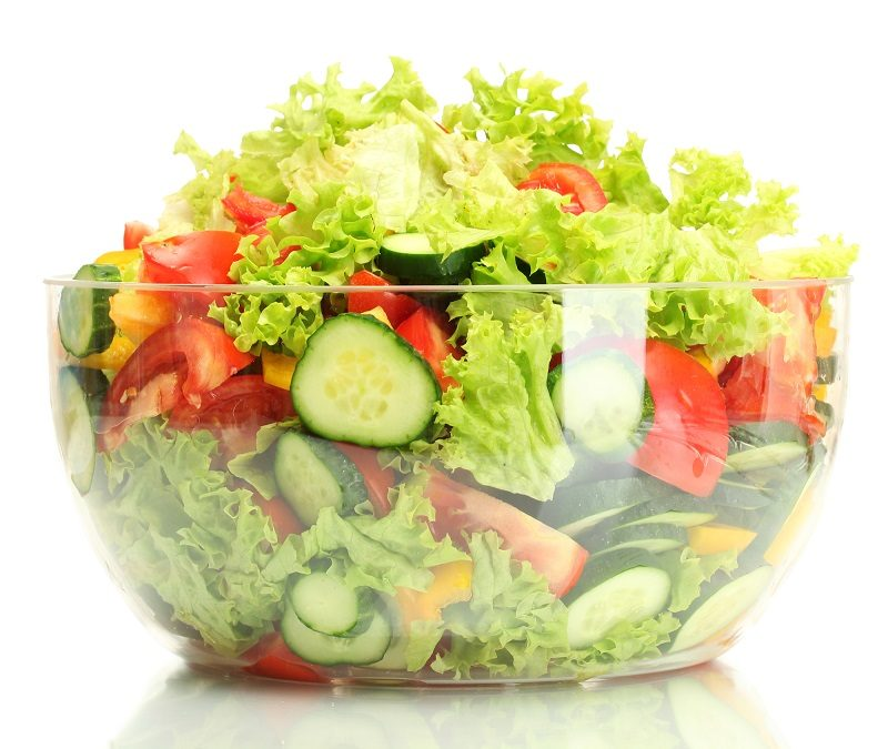 fresh-vegetable-salad-in-transparent-bowl-isolated-on-white