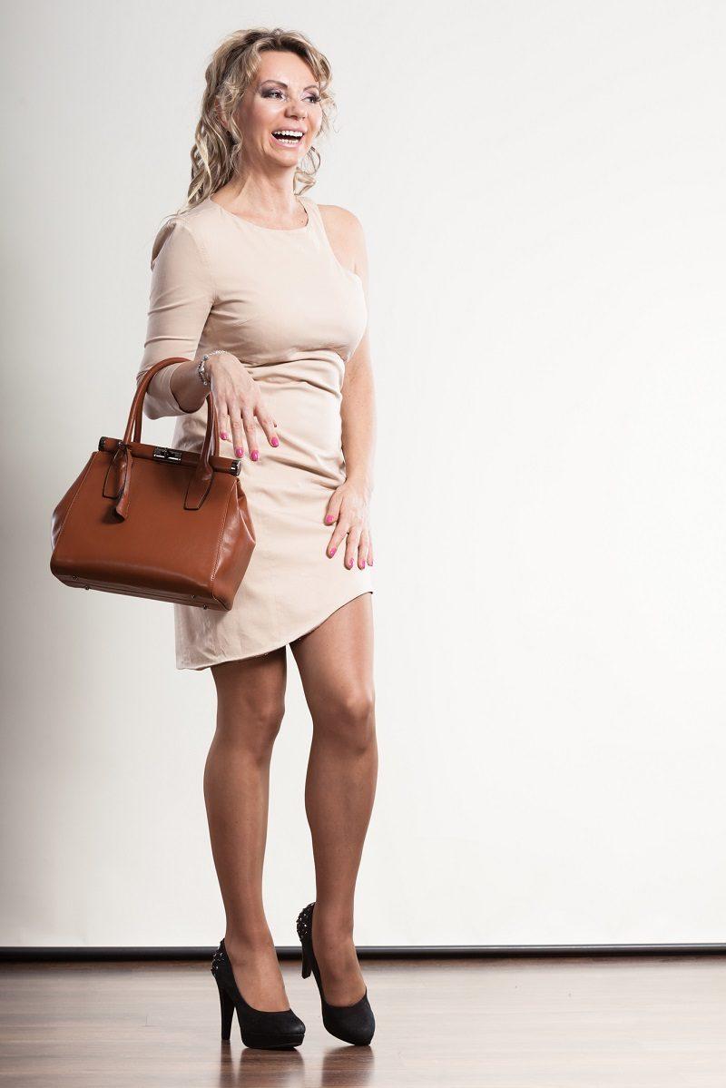 mature-elegant-woman-holds-handbag