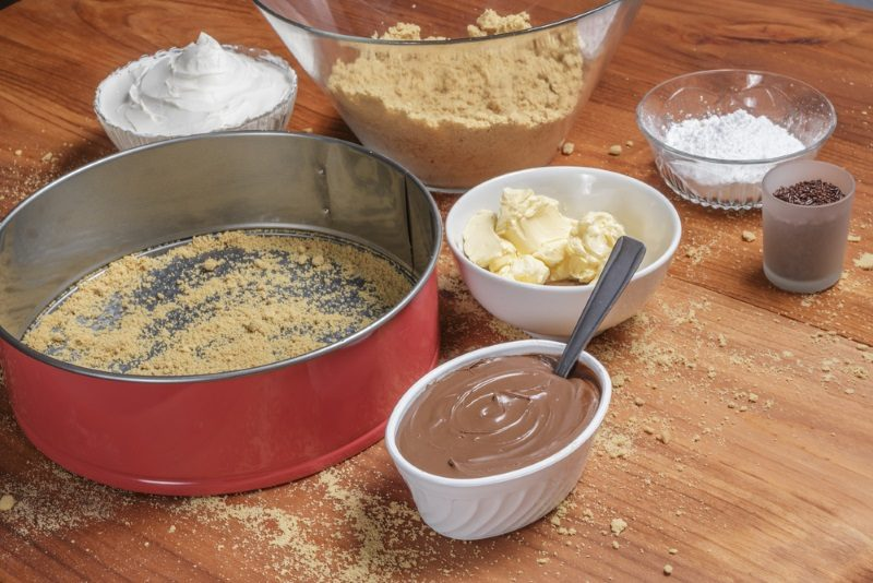 ingredients-for-making-a-chocolate-cheesecake-on-wooden-table