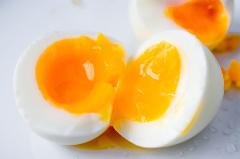 two-soft-boiled-eggs-broken-in-half