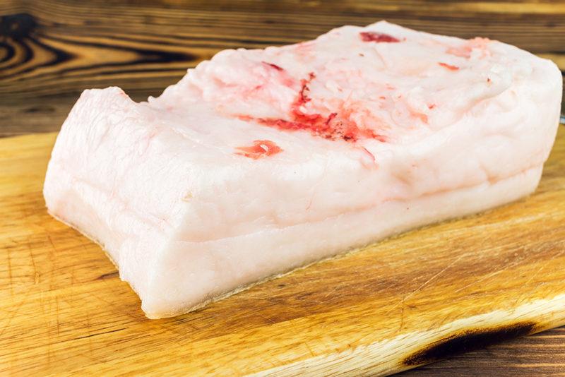 piece-of-fresh-raw-pork-lard-on-wooden-board-rustic-background