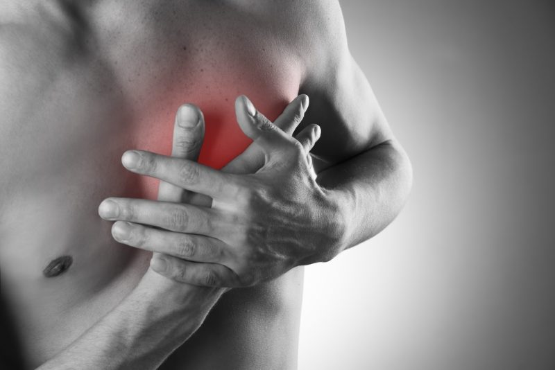 heart-attack-pain-in-the-human-body-black-and-white-photo-with-red-dot