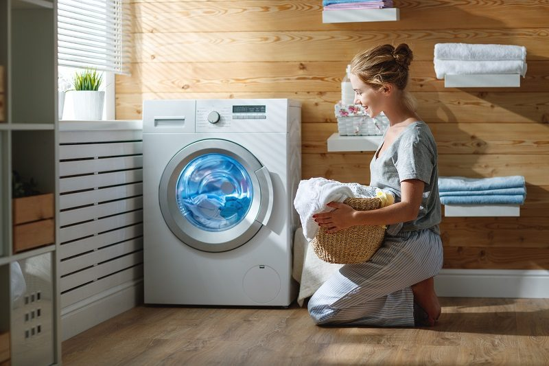 happy-housewife-woman-in-laundry-room-with-washing-machine-2