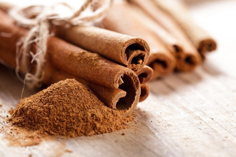 cinnamon-sticks-and-meal-close-up-on-wooden-table