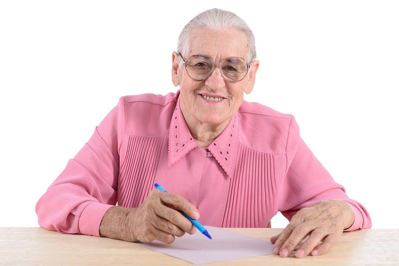 elderly-woman-writes-the-document-2