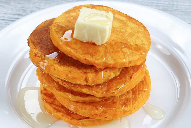 stack-of-pumpkin-pancakes-with-honey-and-butter