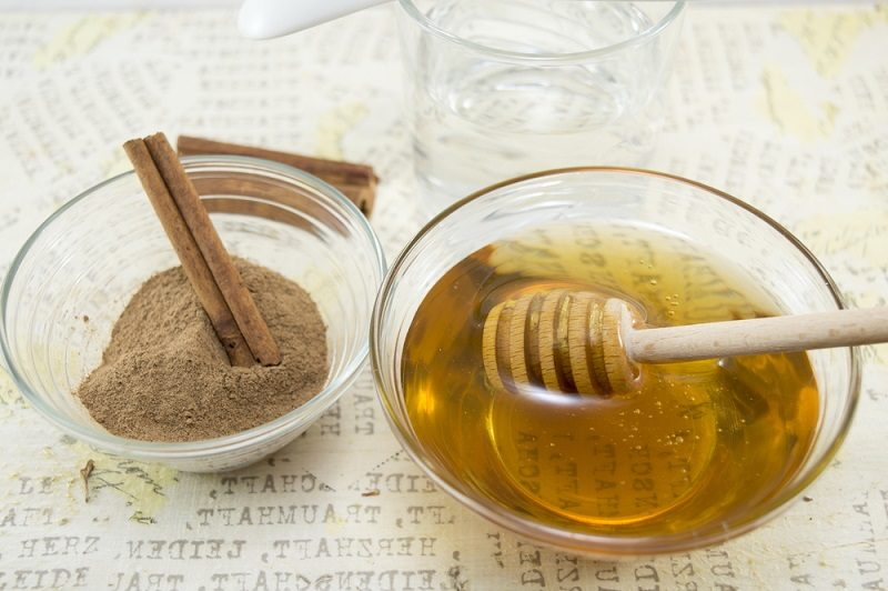 honey-and-cinnamon-in-glass-vessels-on-a-table
