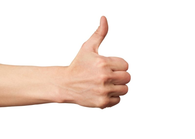 closeup-of-male-hand-showing-thumbs-up-sign-against-white-background-2