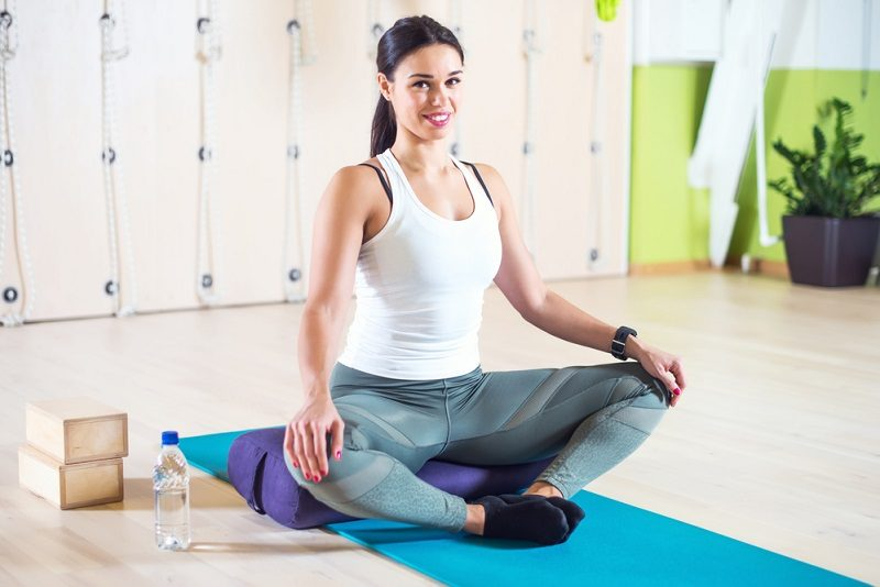 fit-woman-doing-stretching-pilates-exercises-in-fitness-studio-12