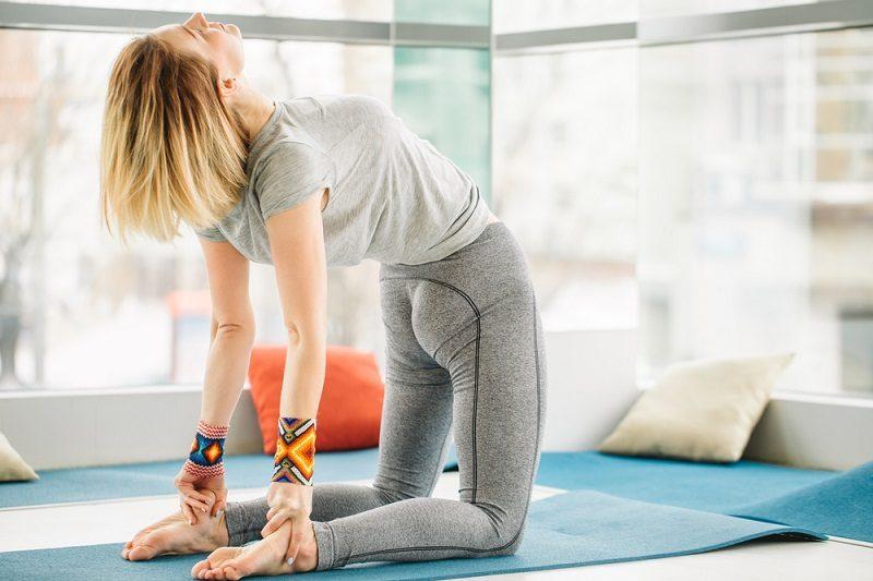yoga-teacher-female-standing-in-ustrasana-camel-posture