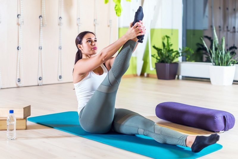 fit-woman-doing-stretching-pilates-exercises-in-fitness-studio-14
