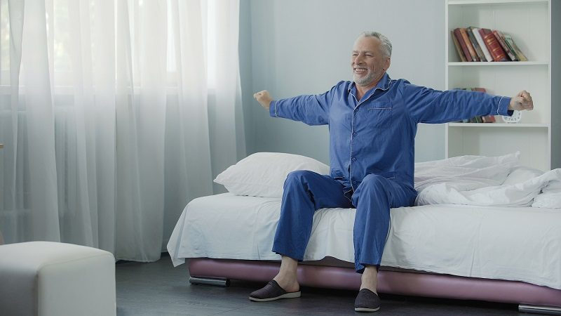 waking-up-full-of-energy-cheerful-pensioner-doing-morning-gymnastics-new-day