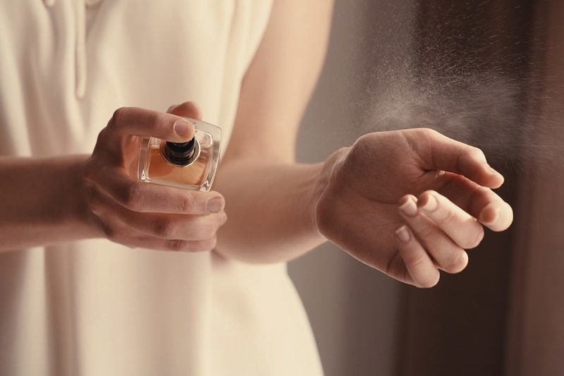 beautiful-young-woman-with-bottle-of-perfume-at-home-closeup-2
