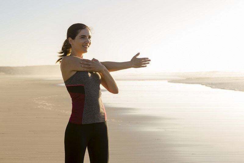 shoot-of-a-beautiful-woman-making-stretching-exercises-in-the-beach