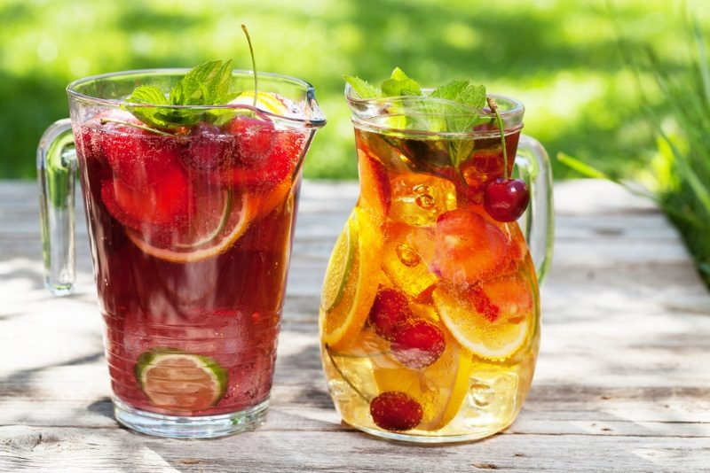 homemade-lemonade-or-sangria-with-summer-fruits-and-berries-outdoor