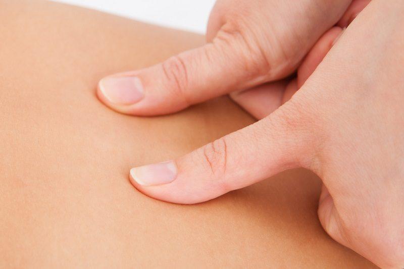 person-receiving-shiatsu-treatment