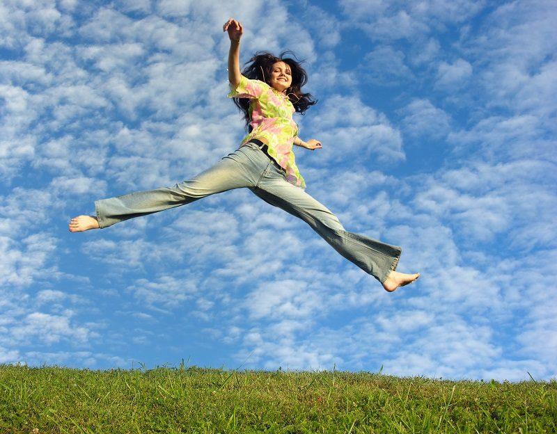 jump-girl-under-cloud-sky