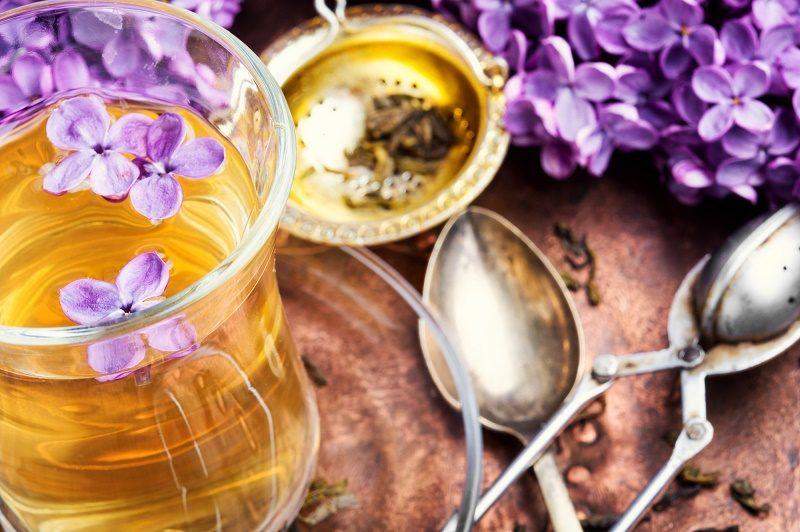 cup-of-fragrant-spring-tea-and-a-branch-of-blossoming-spring-lilac-green-tea