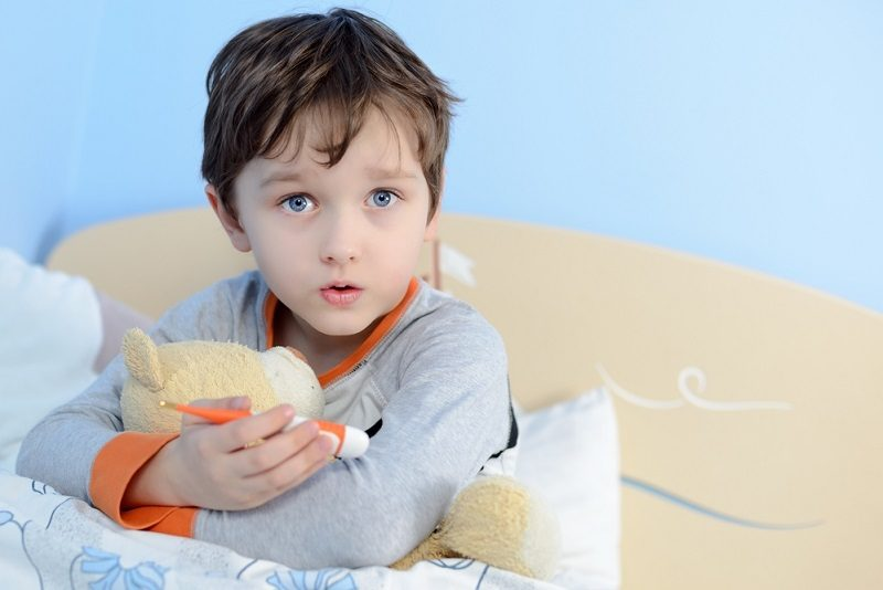 the-little-boy-is-sick-he-lies-in-bed