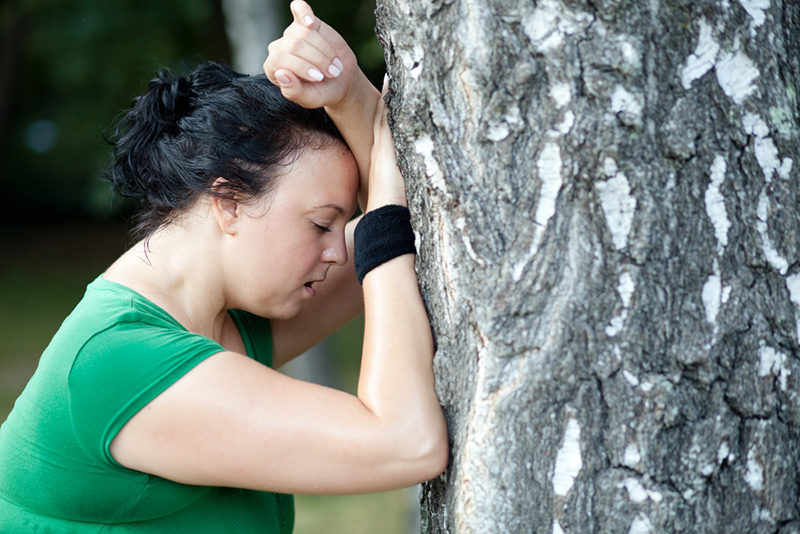sweaty-overweight-woman-catching-her-breath-after-a-long-run