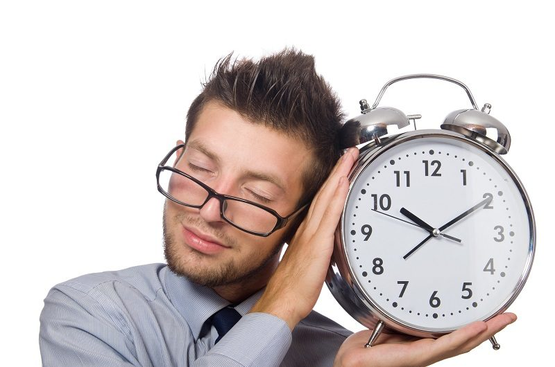 man-with-clock-trying-to-meet-the-deadline-isolated-on-white