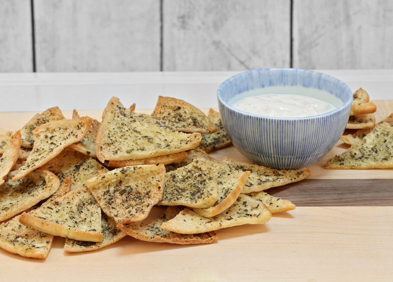 spiced-pita-chips-with-dip-on-a-cutting-board