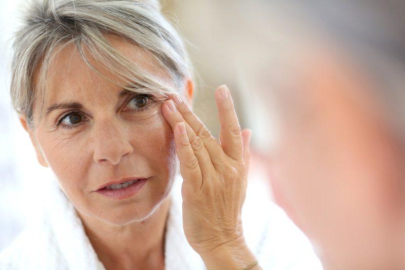 senior-woman-applying-anti-wrinkles-cream