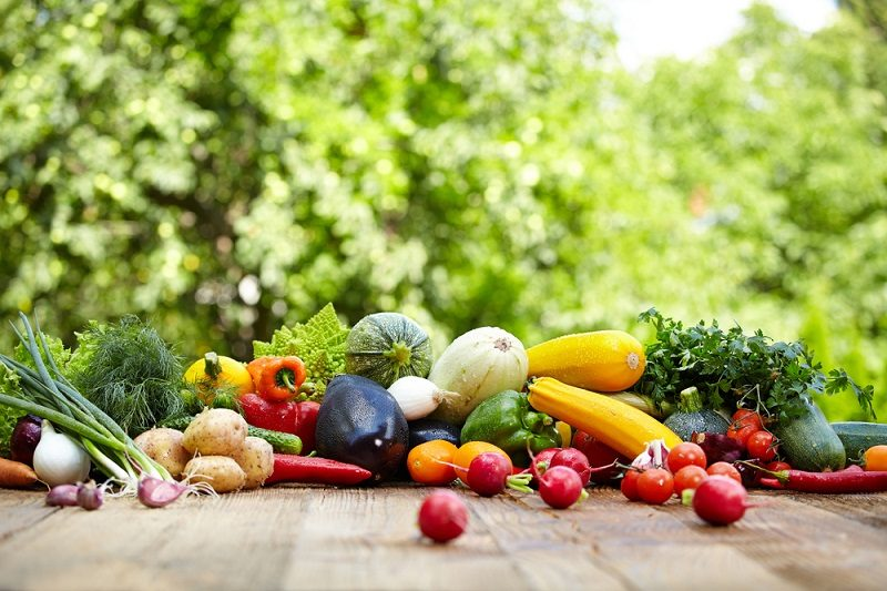 fresh-organic-vegetables-ane-fruits-on-wood-table-in-the-garden