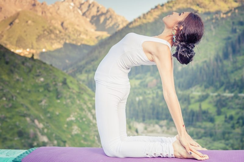 inspired-asian-woman-doing-exercise-of-yoga-at-mountain-range