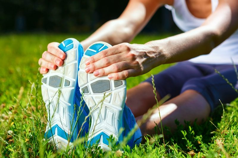 young-woman-stretching-before-exersise-closeup-shot