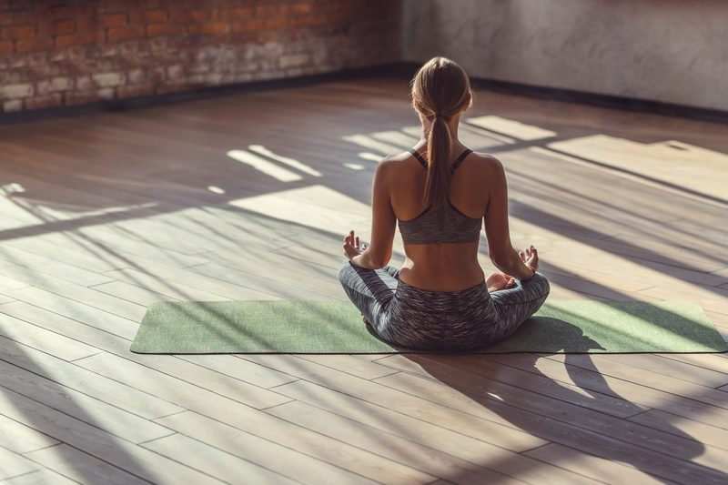 young-woman-in-lotus-pose-indoors