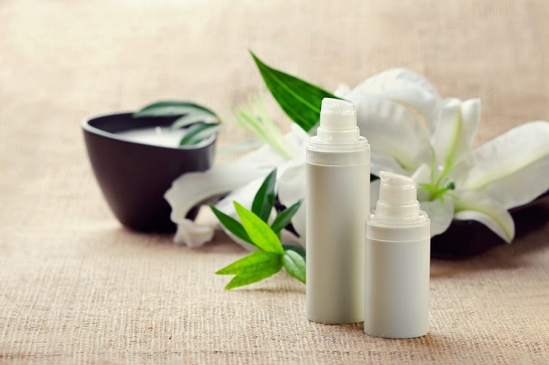 face-body-care-concept-bottles-of-creams-lotions-serums-with-wh-2