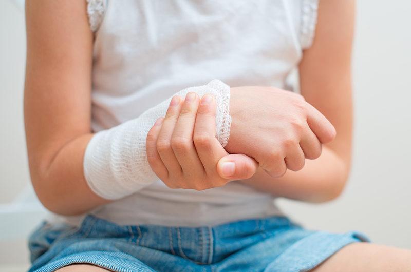 child-arm-with-gauze-bandage-on-it